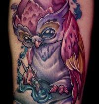 Purple and pink owl tattoo design