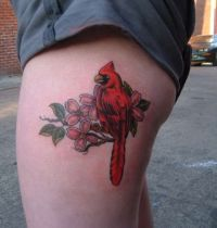 Red bird with cherry blossom tattoo