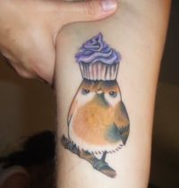 Sparrow with purple cake tattoo