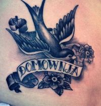Black swallow with flowers tattoo