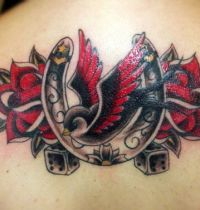Back tatoo with swallow and horseshoe