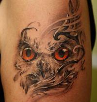 Tattoo owl with orange eyes