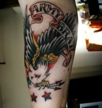Arm tattoo with eagle and ribbon