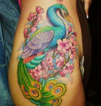 Tattoo with peacock among flowers