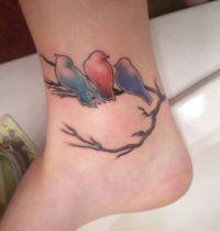 Tattoo with three birds on branch