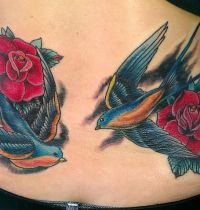 Two swallows and two roses tattoo