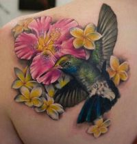 Hummingbird and flowers tattoo
