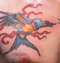 Yellow and blue swallow tattoo