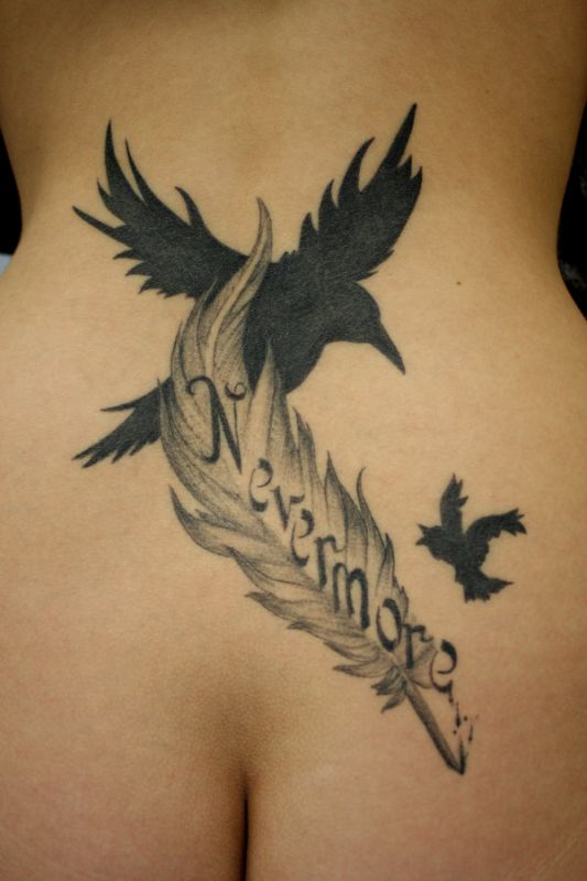 Two black birds and feather tattoo